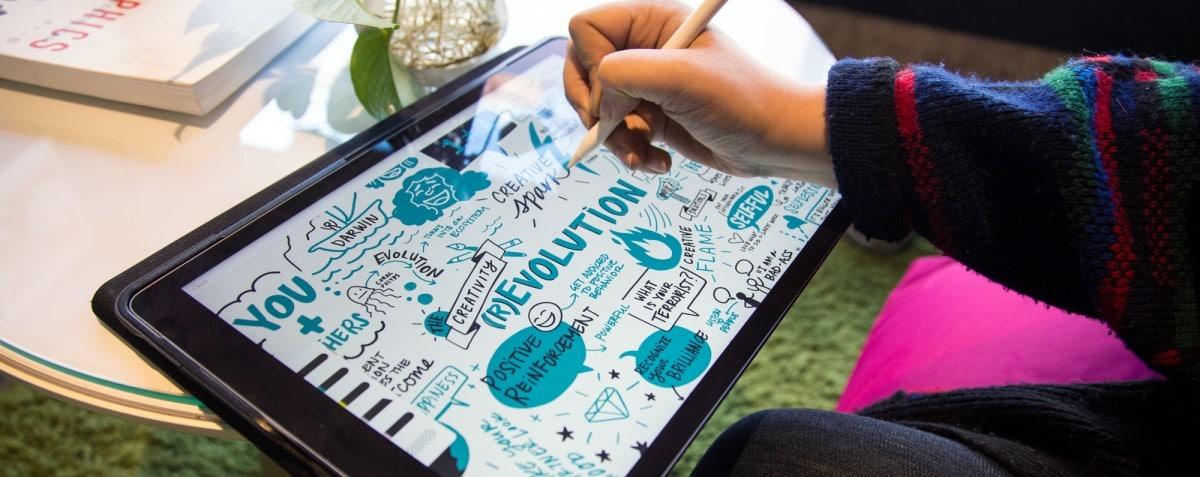An artist creates visual notes on an iPad Pro with an apple pencil.