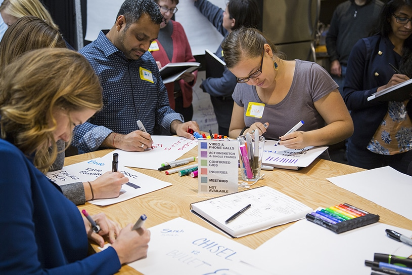 People practice their handwriting and drawing skills during a Visual Note-Taking workshop