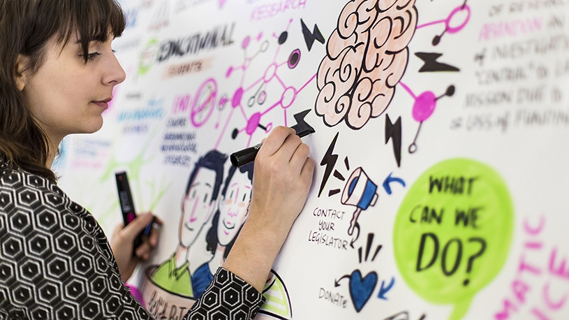 An Ink Factory artist draws live at a Brain Research Foundation Event